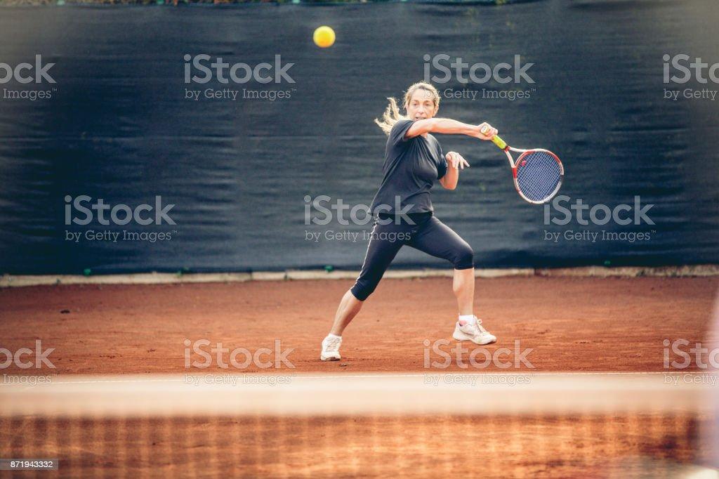 Sportswoman Training Tennis On Clay Court