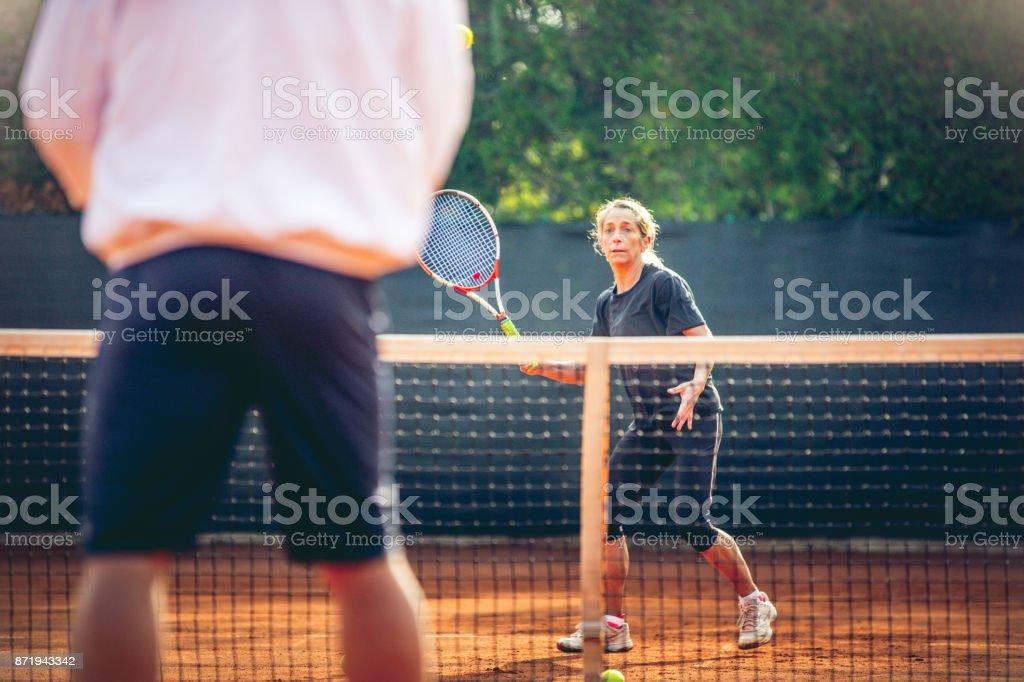 Sportswoman Training Tennis With Tennis Instruction stock photo