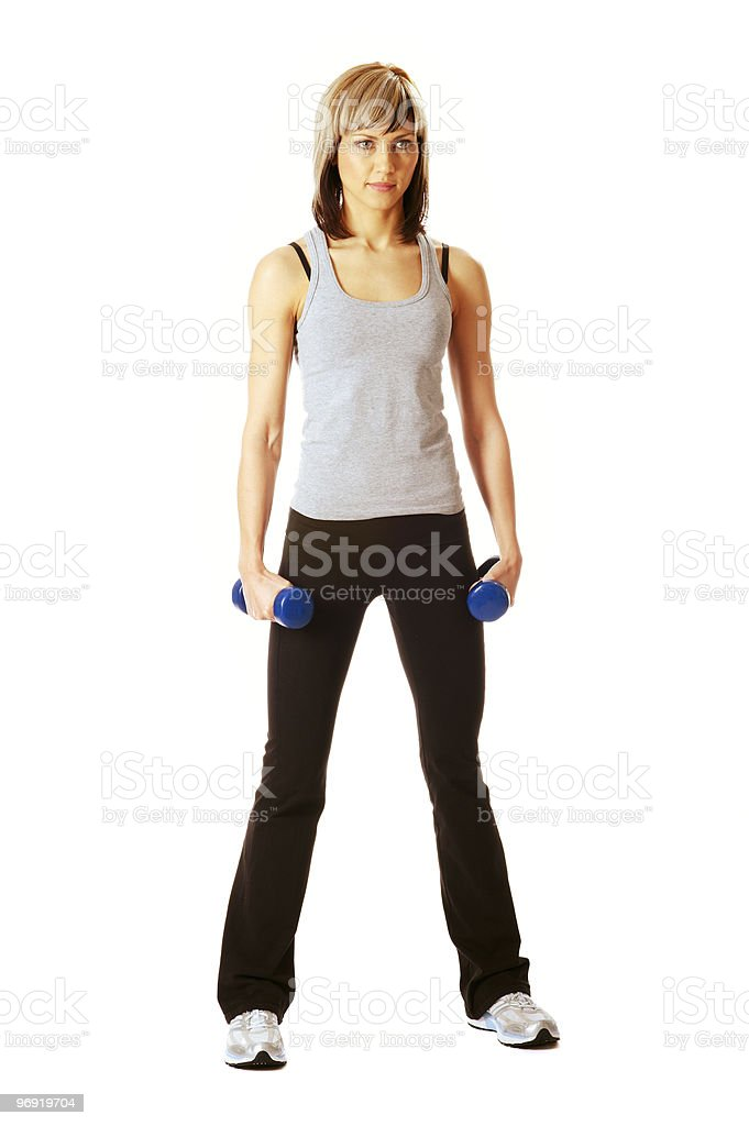 Sportswoman with dumbbells royalty-free stock photo