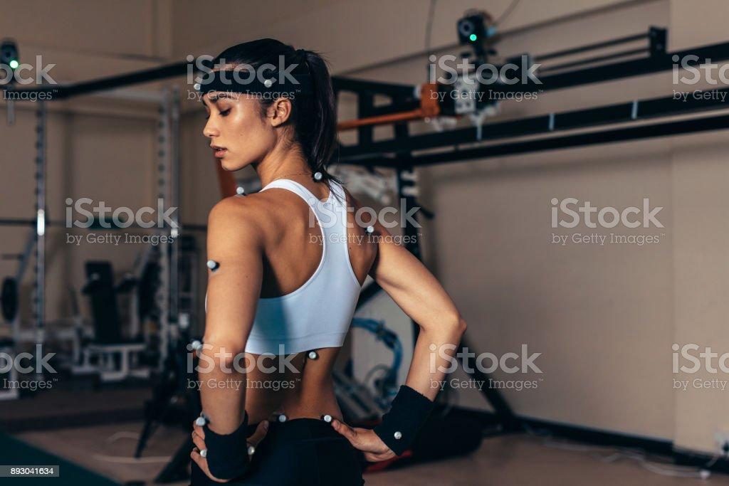 Sportswoman with motion capture sensors stock photo