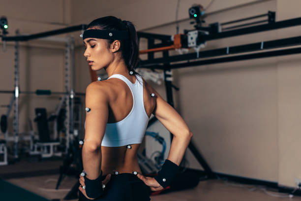 Sportswoman with motion capture sensors stock photo