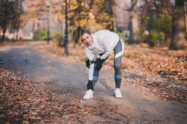 Sportswoman with sprained ankle stock photo
