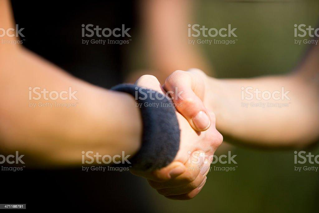 Sportswomen shaking hands royalty-free stock photo