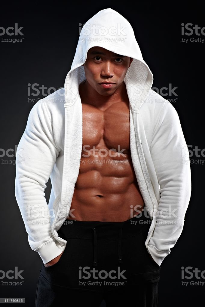Sporty asian man in hooded shirt stock photo
