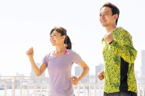sporty asian people jogging sporty asian people jogging only japanese stock pictures, royalty-free photos & images
