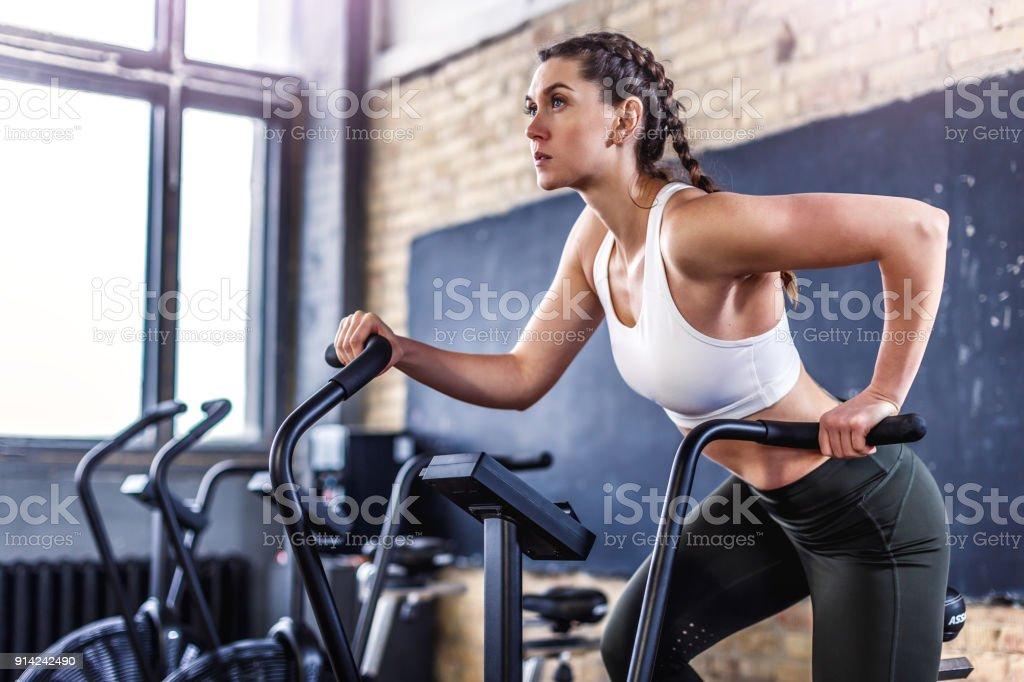 Sporty athletic woman in gym gym