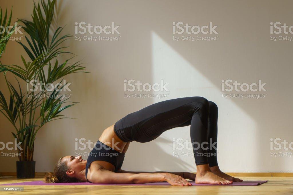 sporty female doing gym exercise - Royalty-free Acrobatic Activity Stock Photo