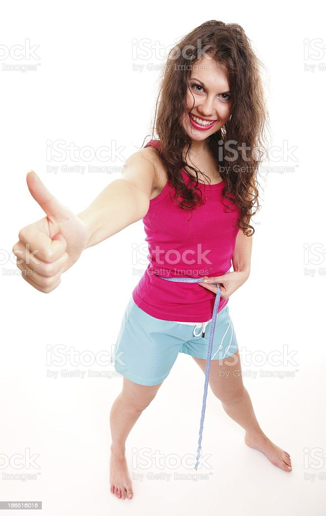 sporty fit woman with measure tape thumbs up royalty-free stock photo