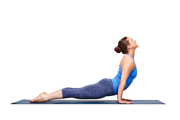 Sporty fit yogini woman practices yoga asana Urdhva mukha svanas Beautiful sporty fit yogini woman practices yoga asana urdhva mukha svanasana - upward facing dog pose in studio isolated on white upward facing dog position stock pictures, royalty-free photos & images