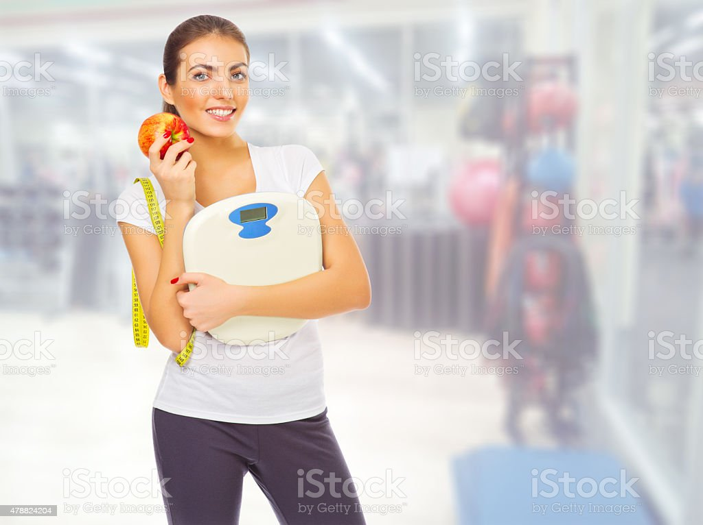 Sporty girl at fitness club stock photo