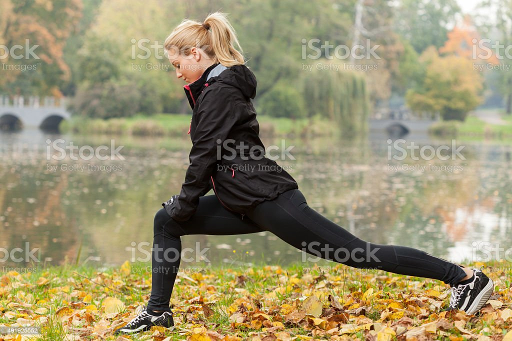 Sporty girl cooling down stock photo