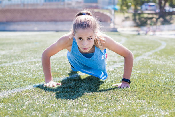 Sporty girl doing push up stock photo