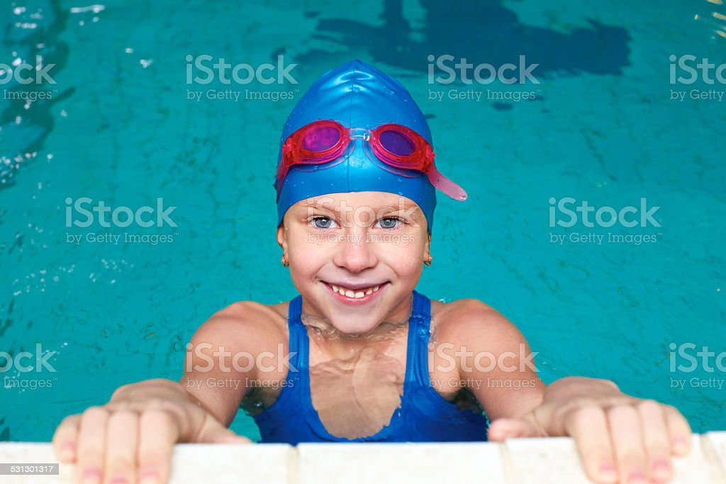 Sporty girl starts in the pool stock photo