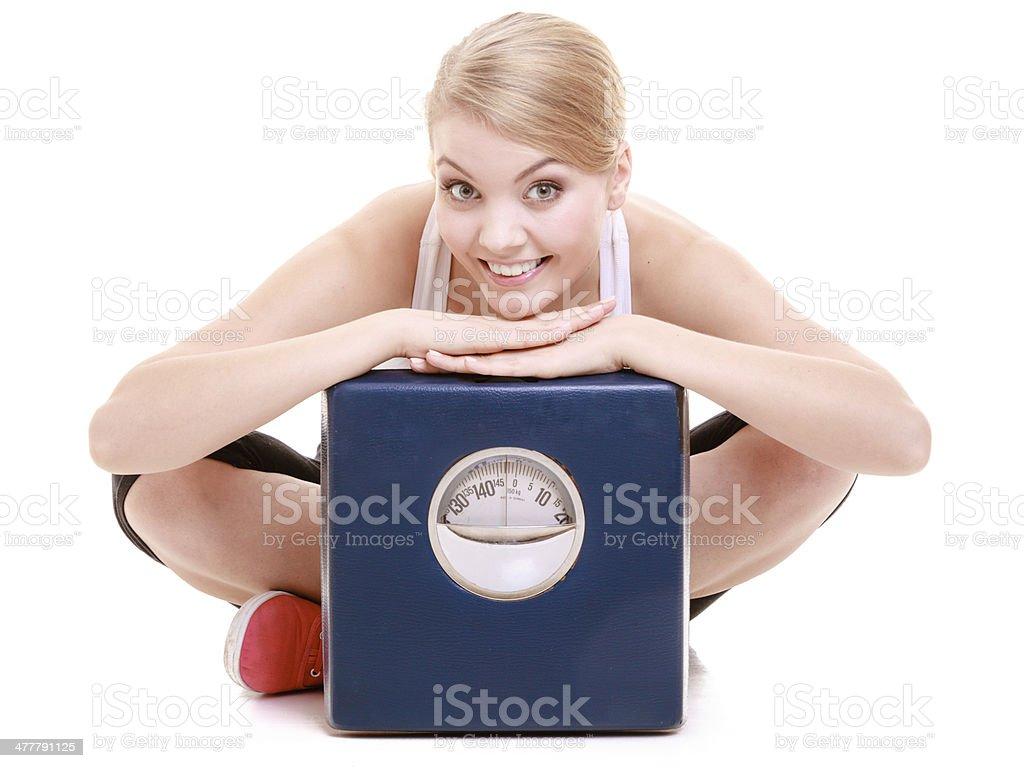 Deportivo mujer feliz con escala y pérdida de peso, el tiempo de tratamiento para adelgazar - Foto de stock de Actividad libre de derechos