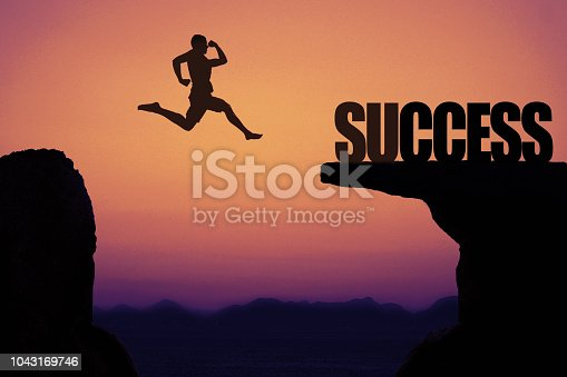 istock Sporty jumping man as symbol for success 1043169746