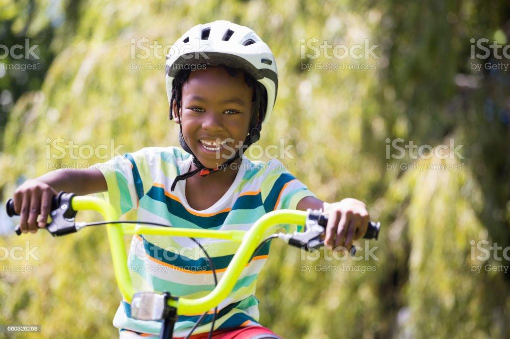 A sporty kid bike riding stock photo