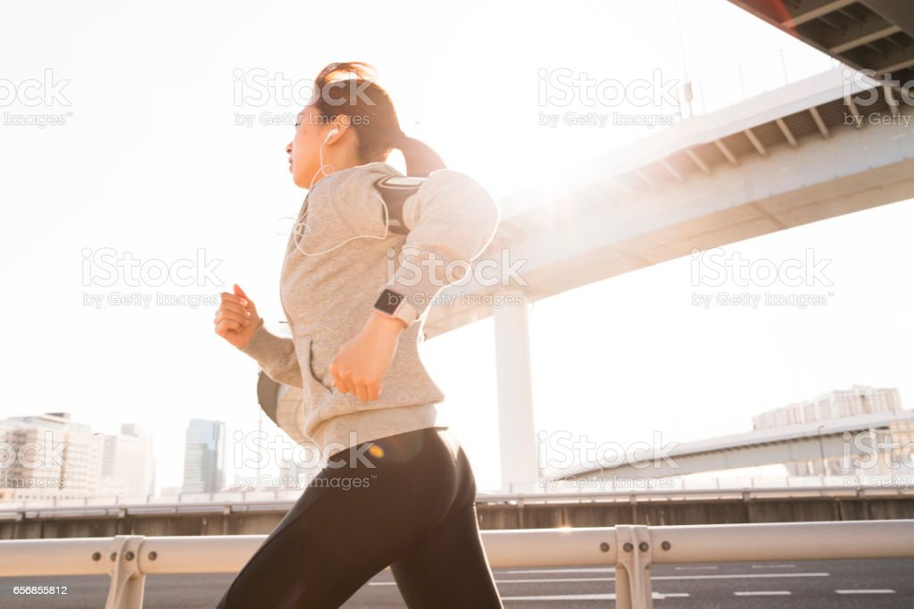 Sporty lady running stock photo