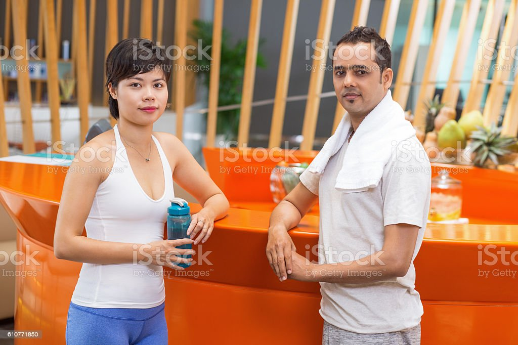 Sporty Man and Woman Standing in Fitness Bar stock photo