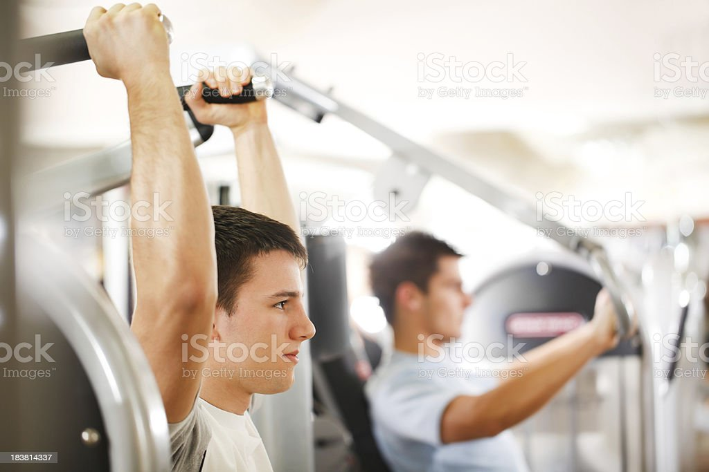Sporty man exercising at a modern gym. royalty-free stock photo