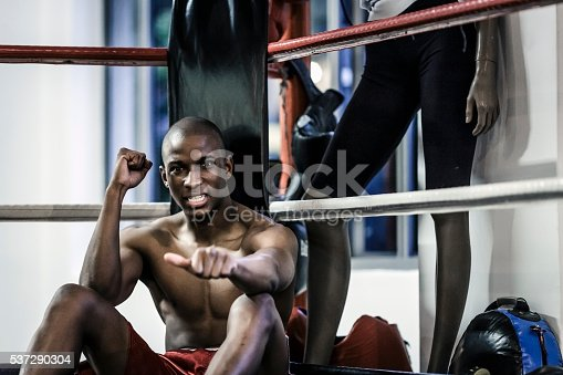 1069872470istockphoto Sporty man gesturing thumbs up in boxing ring 537290304