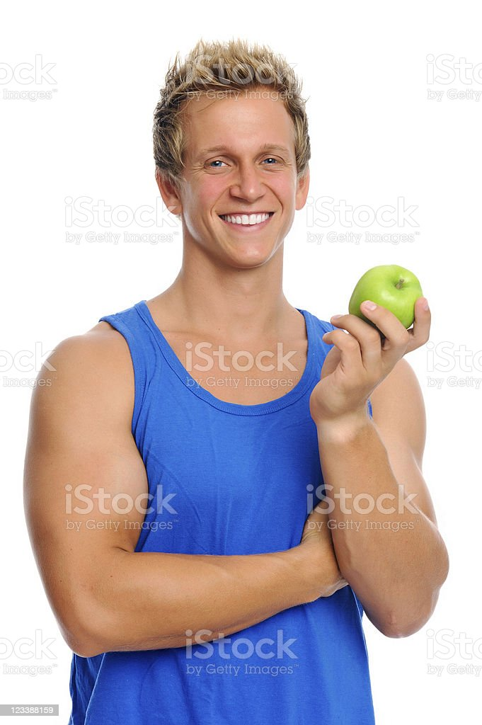 Sporty man with apple royalty-free stock photo