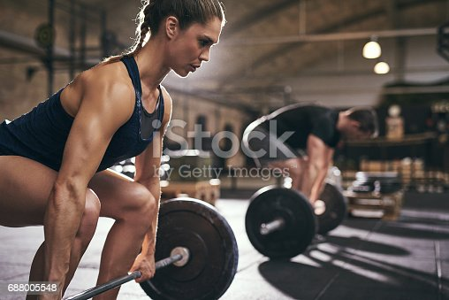 istock Sporty people bend their knees before exercise 688005548
