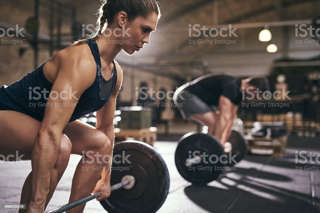 Sporty people bend their knees before exercise stock photo