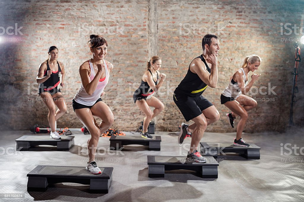 Sporty people on training stock photo
