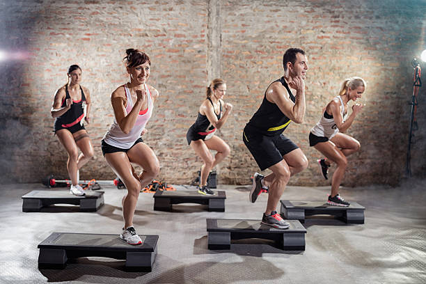 sporty people on training - aerobics stock photos and pictures