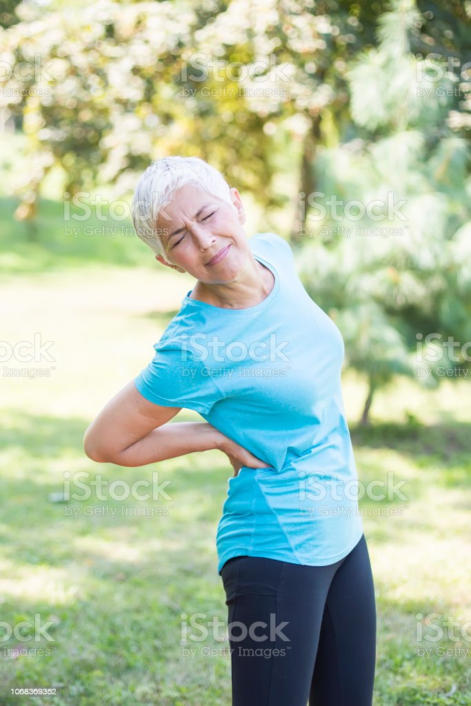 Woman with backache stock photo. Image of bodycare