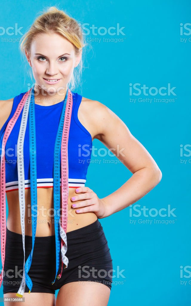 sporty smiling girl with measuring tape royalty-free stock photo