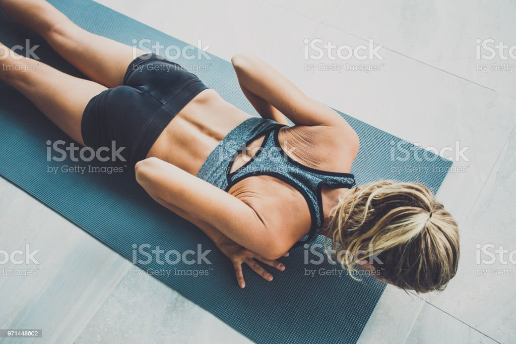 Sporty woman doing exercise in a gym