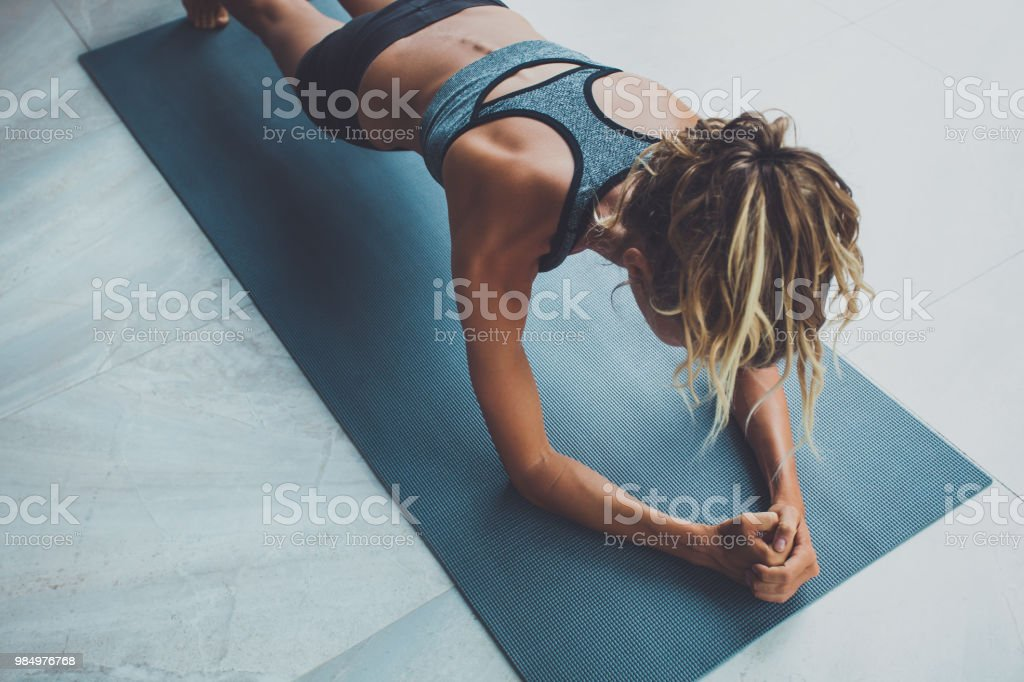 Sporty woman doing exercise in a gym stock photo