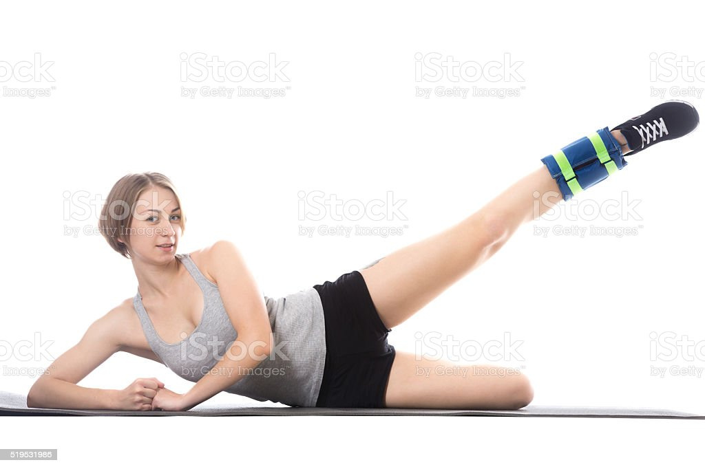 Sporty woman doing exercises for waist stock photo