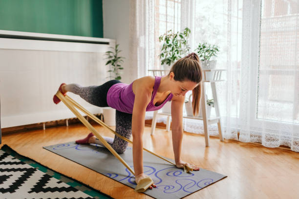 Sporty Woman Doing Pilates Exercise At Home