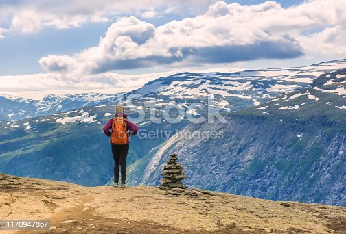 Sporty woman enjoys beautiful view and good weather in Odda, Norway