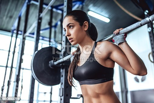 istock Sporty woman in gym 930893718
