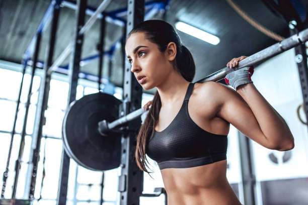 Sporty woman in gym stock photo
