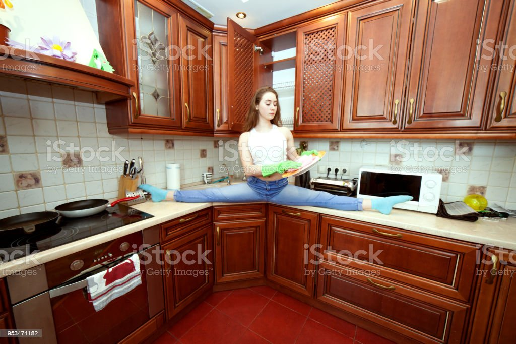 Sporty woman is washing dishes. stock photo