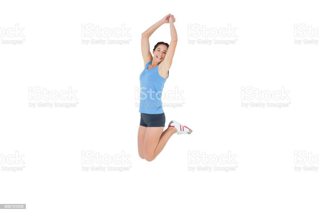 6ea4dd80d Deportiva mujer saltando sobre fondo blanco foto de stock libre de derechos