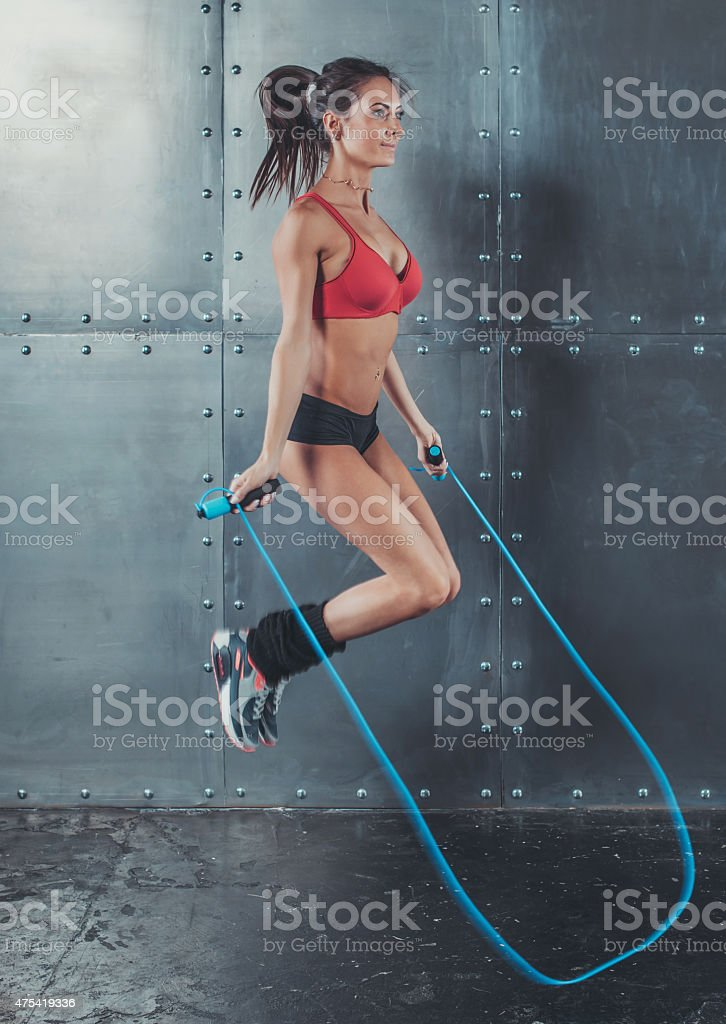 Sporty woman jumping skipping rope concept sport health fitness loss...