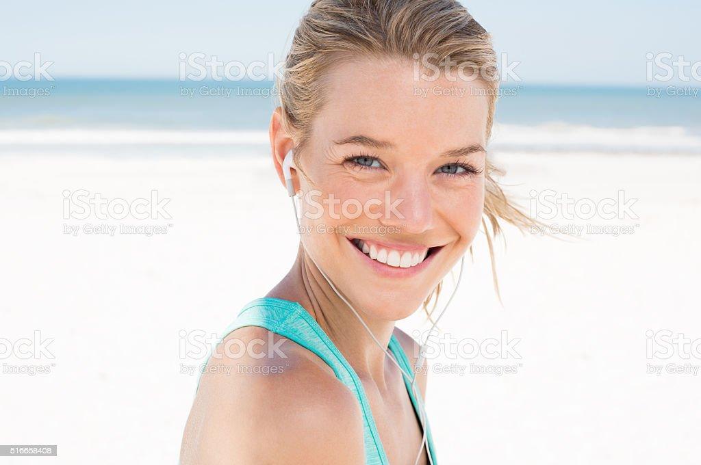 Sporty woman listen music stock photo