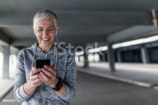 istock Sporty woman making a break from exercising 885559714