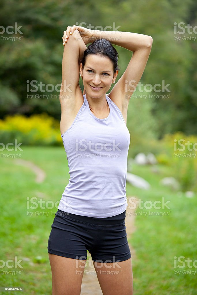 Sporty woman making fitness exercises outdoors royalty-free stock photo