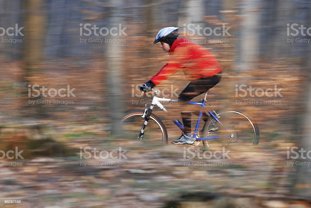 Sporty woman on a bicycle trip royalty-free stock photo