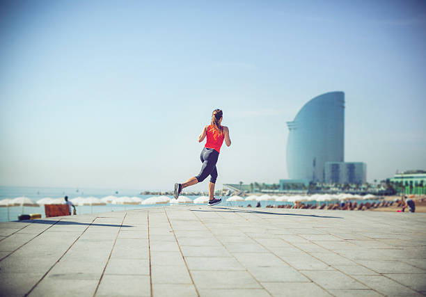 Sporty woman running and training by the beach - foto de stock