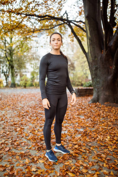 Sporty woman standing at the park. stock photo