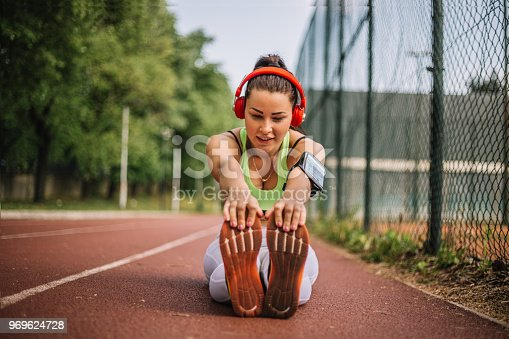 520047182istockphoto Sporty Woman Stretching Legs 969624728