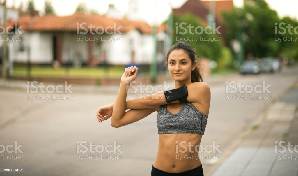 Sporty woman stretching. royalty-free stock photo