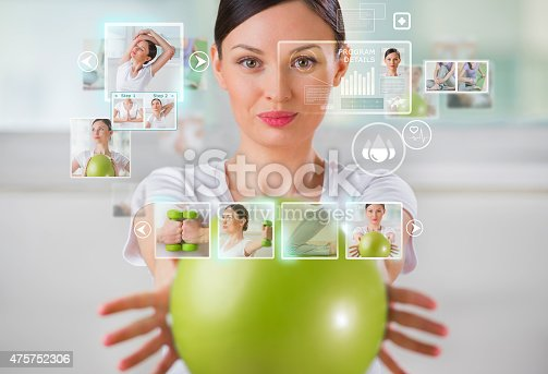 istock Sporty woman working out using modern virtual interface 475752306